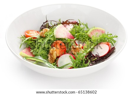 colorful vegetable salad on white background - stock photo