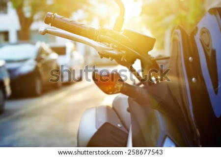 Colorful vibrant handlebar motorcycle in sunrise, soft focus and blur - stock photo