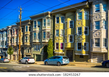 Colorful Victorian homes in San Francisco, California, USA. - stock photo