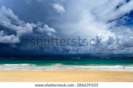 colorful view of the ocean and clouds - stock photo