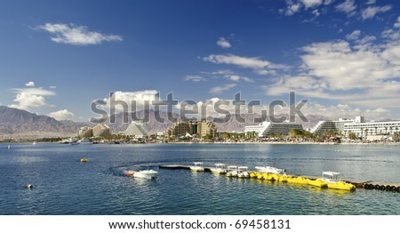 Colorful view on the Aqaba gulf from a swimming bridge, Eilat, Israel - stock photo