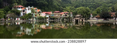 Colorful Village and Pagoda on Lake Near Hanoi Vietnam - stock photo