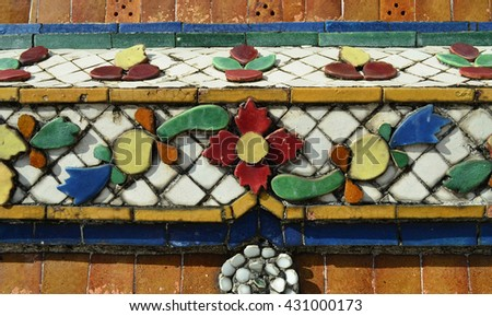 Colorful vintage flower ceramic tile decoration at buddhist temple , Wat Pho Bangkok, Thailand - stock photo