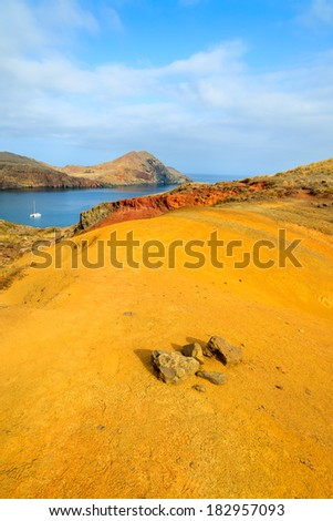 Colorful volcanic soil on trekking path at Punta de Sao Lourenco peninsula, Madeira island, Portugal  - stock photo