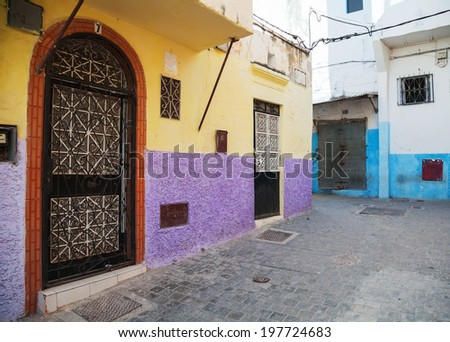 Colorful walls and doors in Medina, old part of Tangier, Morocco - stock photo