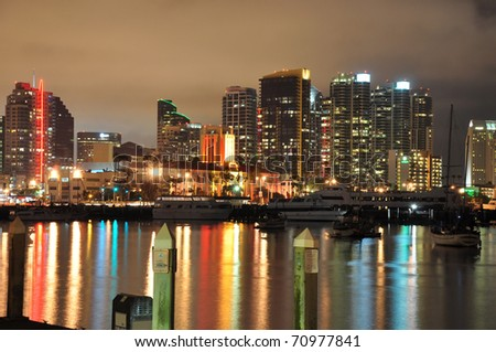 Colorful water reflections of the downtown San Diego skyline. - stock photo