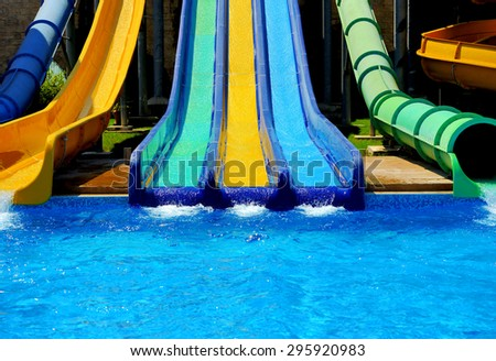 Colorful water slides at the water park - stock photo