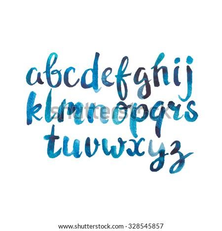 Colorful watercolor aquarelle font type handwrittn doodle en hand drawabc alphabet letters. - stock photo