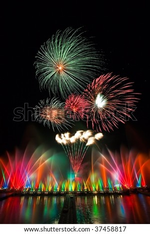 Colorful waterdancing performance and fireworks - stock photo