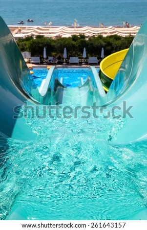 Colorful waterpark tubes and a swimming pool. Outdoor shot - stock photo