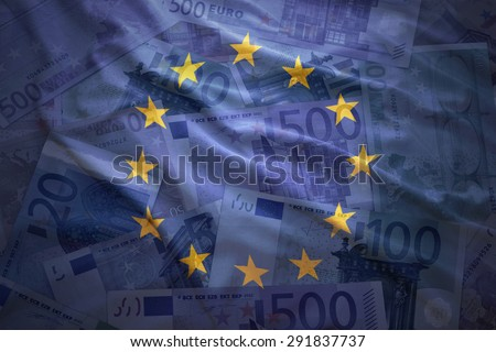 colorful waving european union flag on a euro money background - stock photo