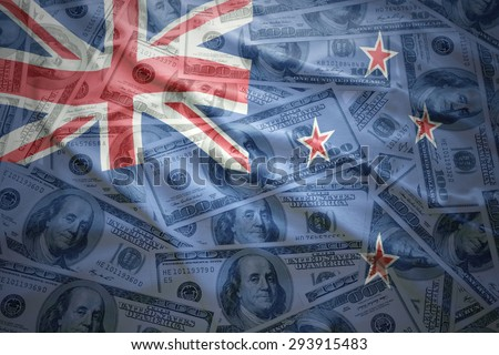 colorful waving new zealand flag on a american dollar money background - stock photo