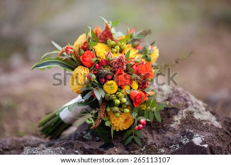 Colorful wedding bouquet with roses and gerbera - stock photo