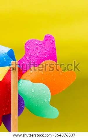 Colorful wind spinner toy - stock photo