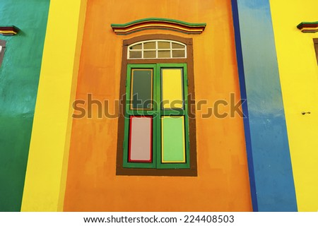 Colorful window on a colonial house in Little India, Singapore - stock photo
