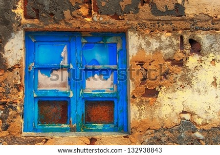 Colorful window, one window in a yellow gold colorfull background, window in colorful background, old aged window, blue window, old stone wall and blue window, time, abstract, artistic photo of window - stock photo