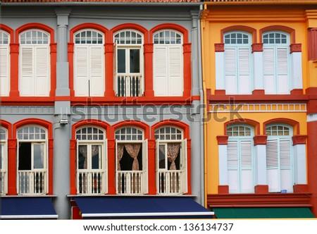 colorful windows facade, public urban street design, old shophouse at china town singapore - stock photo