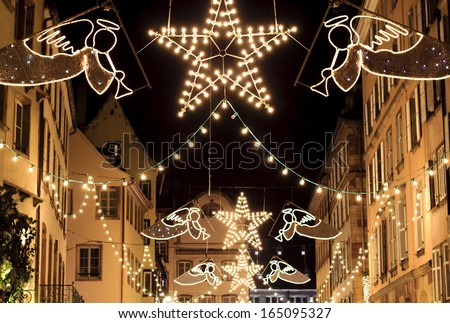 Colorful winter holidays decorations on the old Alsace style houses, Strasbourg, France - stock photo