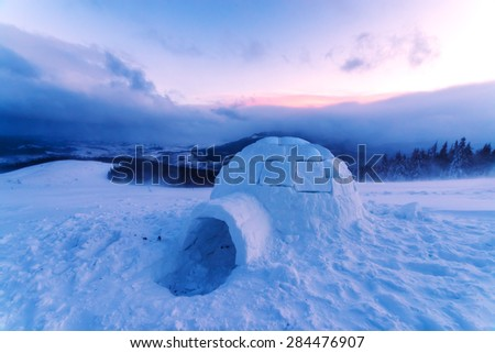 Colorful winter sunset in the Carpathian mountains. Snowy ihloo on a foreground. Ukraine, Europe.  - stock photo