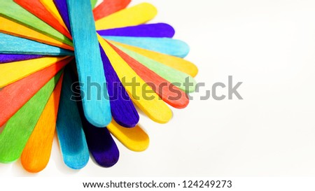 colorful wood ice-cream stick on white background - stock photo