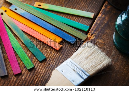 Colorful wood stain or dye color test samples on rough wood surface. Shallow depth of field. - stock photo