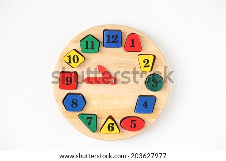Colorful wooden and any shape clock isolated on a white background - stock photo