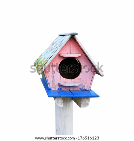 Colorful wooden bird house isolated on white background - stock photo