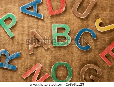 Colorful wooden numbers on wooden background - stock photo