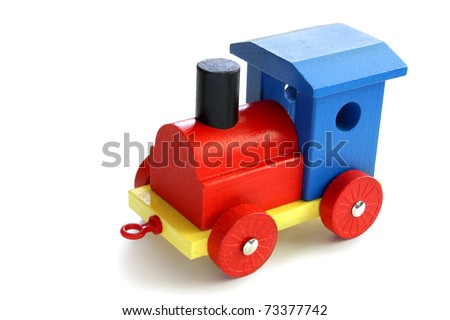 colorful wooden toy train isolated in white - stock photo