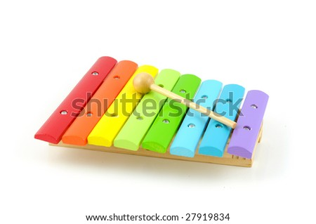 Colorful wooden xylophone with stick isolated on white background - stock photo