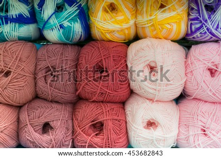 Colorful wool yarn balls on store display. - stock photo