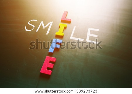 Colorful word life and writing word smile crossing on blackboard - stock photo