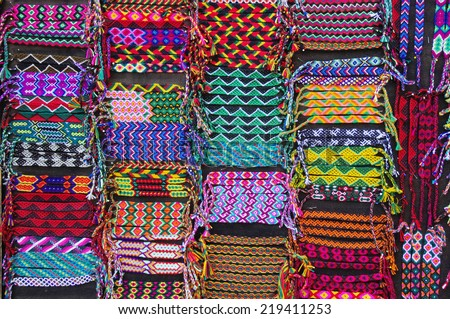 Colorful woven bracelets for sale, Latin America  - stock photo