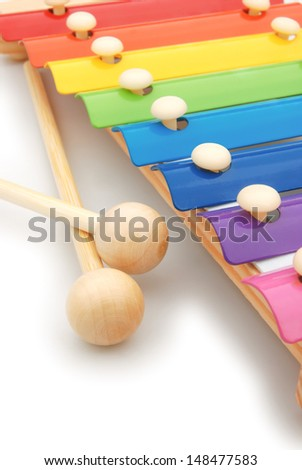 colorful xylophone on white with copy space, vertical - stock photo