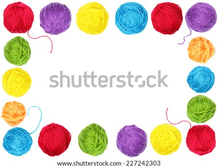 Colorful yarn balls as a frame isolated on white background - stock photo