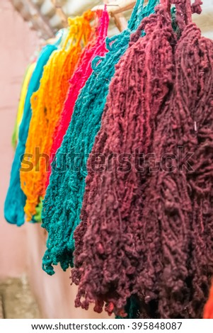 Colorful yarns traditionally made of Llama and Alpaca in Andes Mountains near Cusco, Peru - stock photo