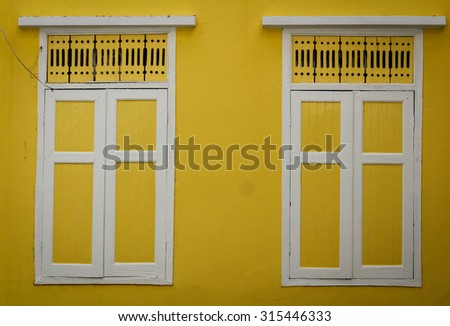 Colorful yellow window. - stock photo