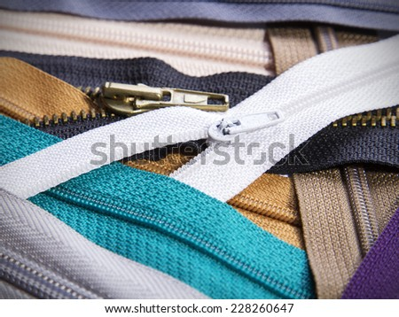 Colorful zippers background - stock photo