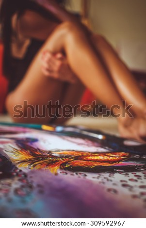 Colorfull canvas with woman's legs on background. - stock photo