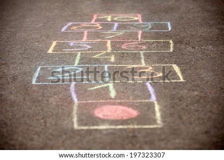 colorfull hopscotch on asphalt - stock photo