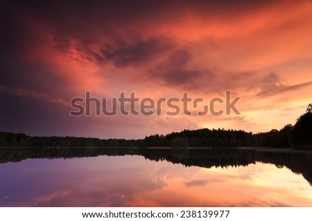 Colorfull sunset on Bobiencino lake in north Poland. Pomerania province. / Silent Place  - stock photo