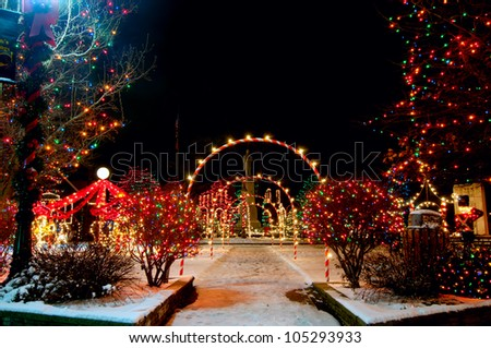 Colorfully lighted village square Christmas display in Bedford, Ohio - stock photo