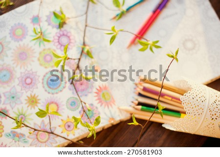 coloring book and colorful pencils - stock photo