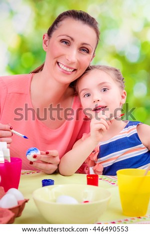 coloring easter eggs at home - stock photo
