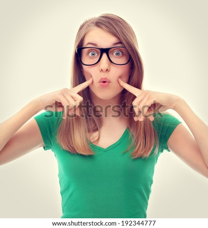 Colors.Anorexia/Portrait of a beautiful girl, puffed out his cheeks and blowing - stock photo