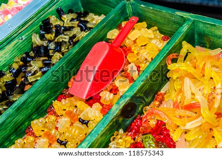 Colors candies for sale are sorted into pots / Candies on sale / Candy - stock photo