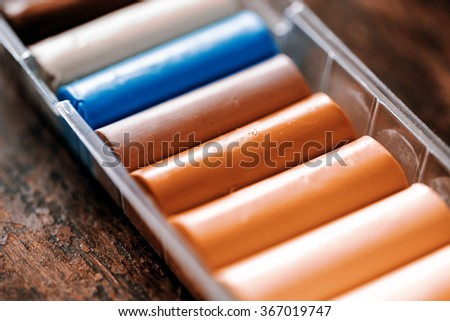 colors of play dough on the wooden table - stock photo