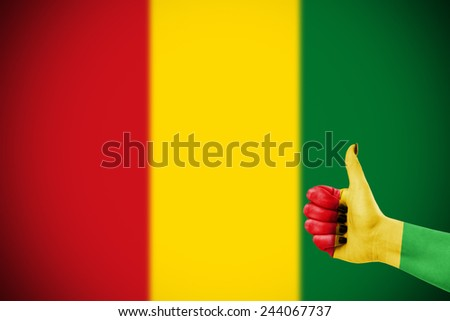 Colors of reggae music applied on hand - stock photo