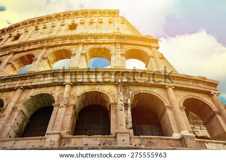 Coloseum against bright bluse sky in Rome Italy - stock photo