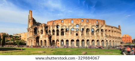Colosseo in Rome. Wide angle view of the famous Flavian amphitheater in Rome. Motion blurred effect.  - stock photo